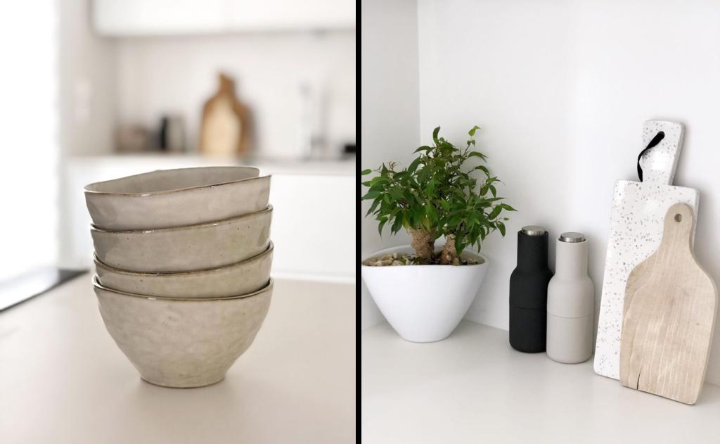 Des détails et de jolis accessoires: des bols en céramique, une plante et des planches à découper en terrazzo et en bois
